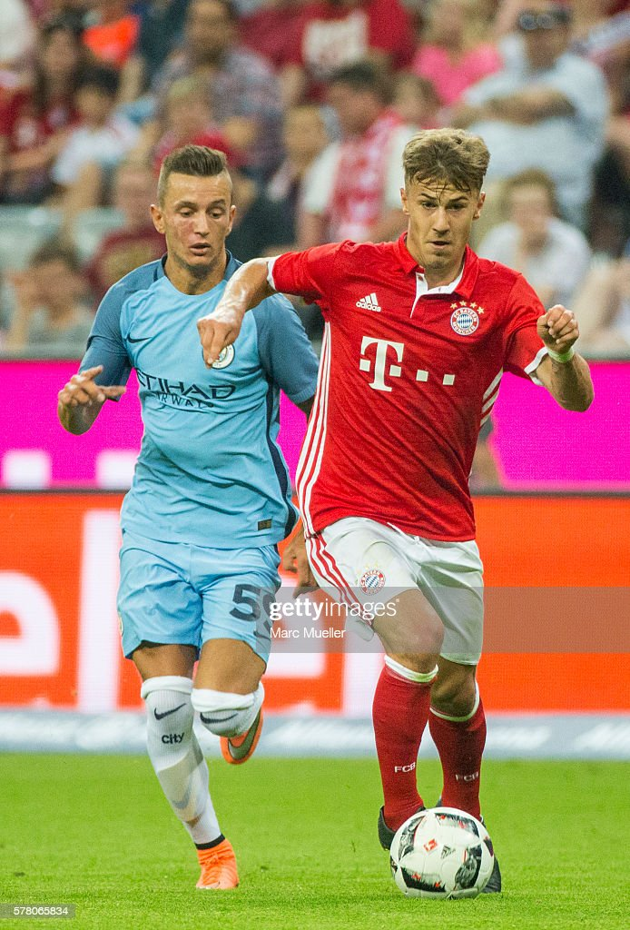 Niklas Dorsch of Bayern Munich is challenged by Bersant Celina of Manchester City during a friendly match between Bayern Munich and Manchester City...