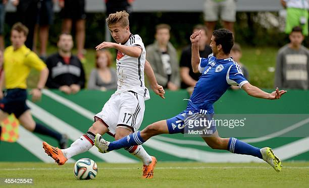 Niklas Dorsch of Germany is challenged by Galili Bar of Israel during the KOMM MIT tournament match between U17 Germany and U17 Israel on September...