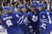 Niklas Hagman Mikhail Grabovski Francois Beauchemin and Garnet Exelby of the Toronto Maple Leafs celebrate a third period goal against the Ottawa...