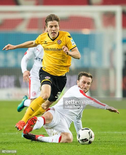 Niklas Hauptmann of Dresden and Adam Bodzek of Duesseldorf in action during the Second Bundesliga match between Fortuna Duesseldorf and SG Dynamo...