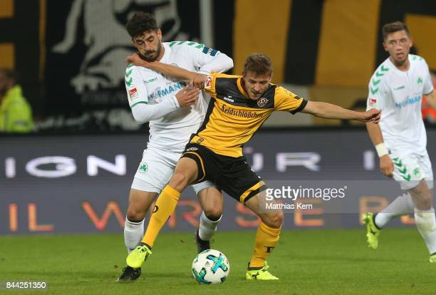 Niklas Hauptmann of Dresden battles for the ball with Tolcay Cigerci of Fuerth during the Second Bundesliga match between SG Dynamo Dresden and SpVgg...