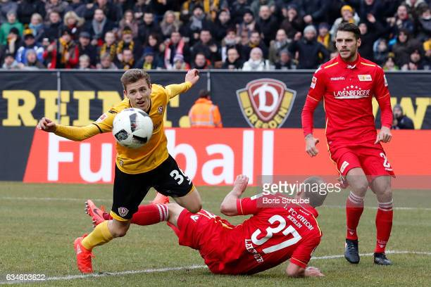 Niklas Hauptmann of SG DYnamo Dresden is challenged by Toni Leistner of Union Berlin during the Second Bundesliga match between SG Dynamo Dresden and...