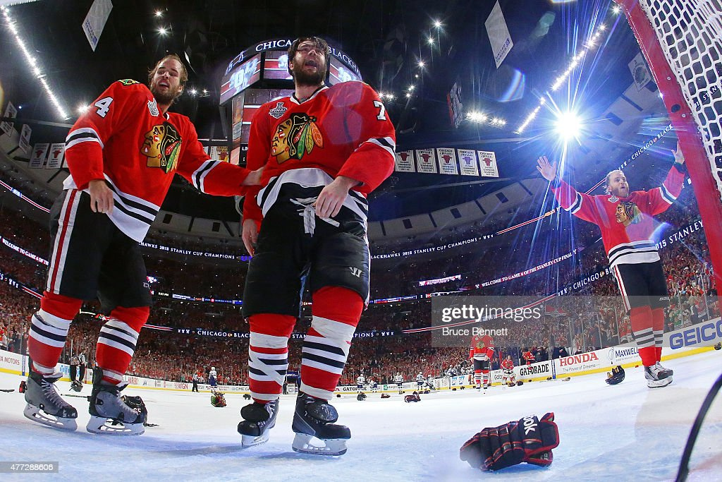 Niklas Hjalmarsson #4, Brent Seabrook #7 and Patrick Kane #88 of the Chicago Blackhawks celebrate after defeating the Tampa Bay Lightning by a score of 2-0 in Game Six to win the 2015 NHL Stanley Cup Final at the United Center on June 15, 2015 in Chicago, Illinois.