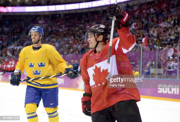 Niklas Hjalmarsson of Sweden reacts as Chris Kunitz of Canada celebrates after scoring a thirdperiod goal during the Men's Ice Hockey Gold Medal...