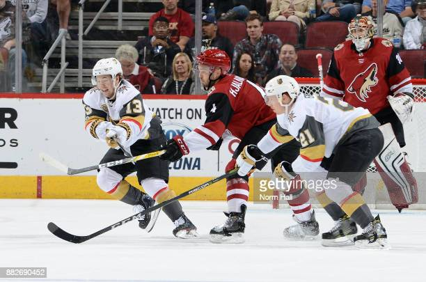 Niklas Hjalmarsson of the Arizona Coyotes battles for position between Brendan Leipsic and Cody Eakin of the Vegas Golden Knights at Gila River Arena...