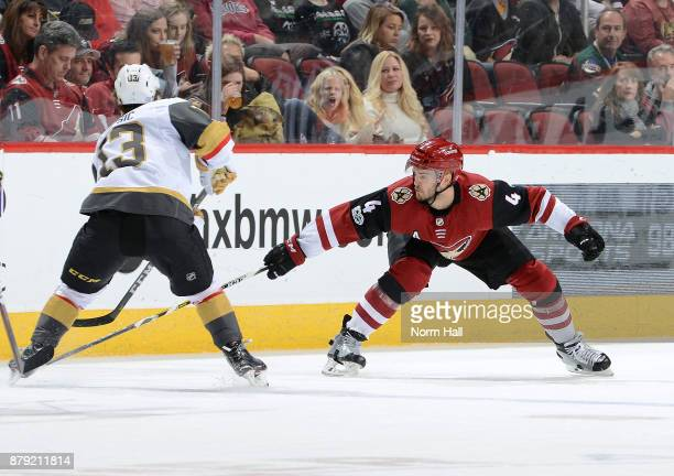 Niklas Hjalmarsson of the Arizona Coyotes reaches in to knock the puck away from Brendan Leipsic of the Vegas Golden Knights during the second period...