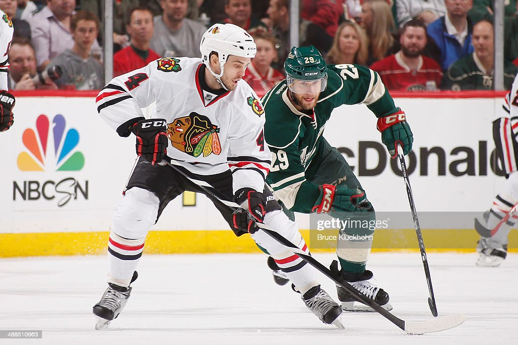 Niklas Hjalmarsson #4 of the Chicago Blackhawks skates with the puck while Jason Pominville #29 of the Minnesota Wild defends during Game Three of the Second Round of the 2014 Stanley Cup Playoffs on May 6, 2014 at the Xcel Energy Center in St. Paul, Minnesota.