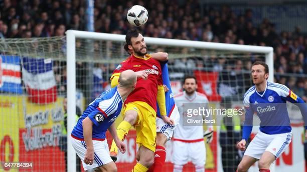 Niklas Hoheneder of Kiel and Koen van der Biezen of Paderborn compete for the ball during the 3 liga match between Holstein Kiel and SC Paderborn at...
