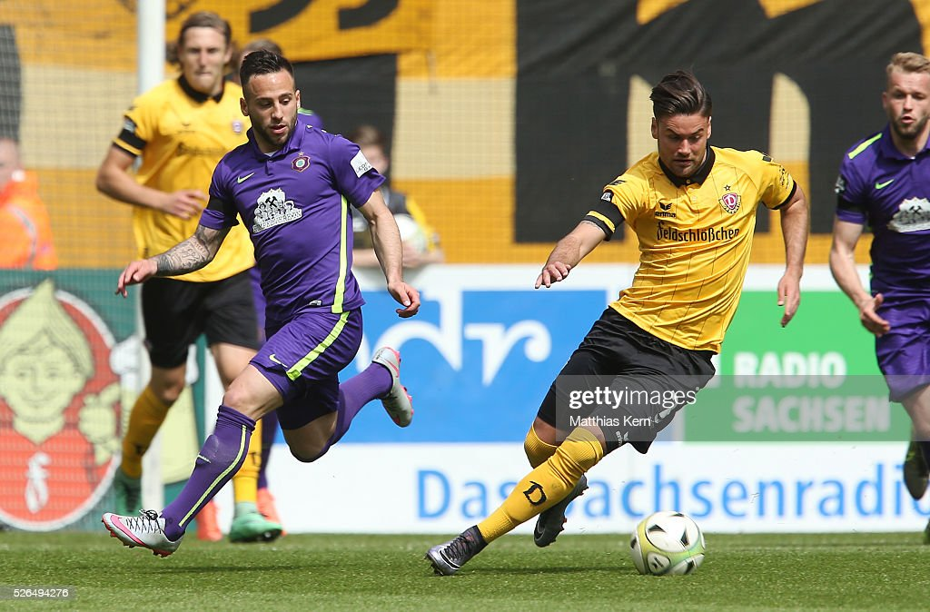 Niklas Kreuzer (R) of Dresden battles for the ball with Calogero Rizzuto (L) of Aue during the third league match between SG Dynamo Dresden and Erzgebirge Aue at DDV Stadion Dresden on April 30, 2016 in Dresden, Germany.