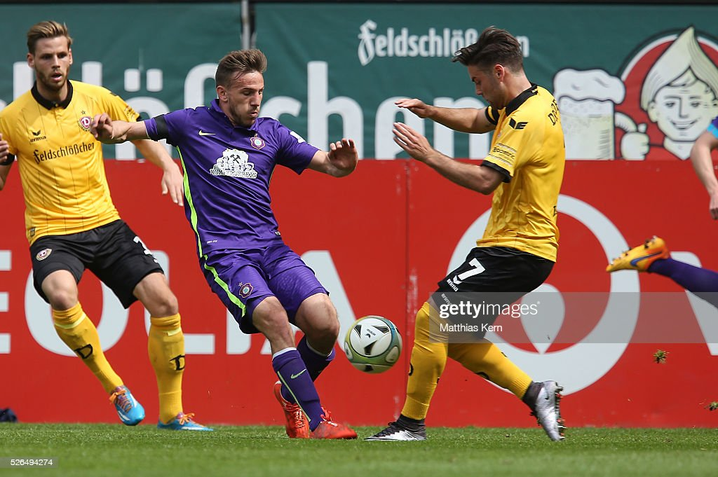 Niklas Kreuzer (R) of Dresden battles for the ball with Simon Skarlatidis (L) of Aue during the third league match between SG Dynamo Dresden and Erzgebirge Aue at DDV Stadion Dresden on April 30, 2016 in Dresden, Germany.