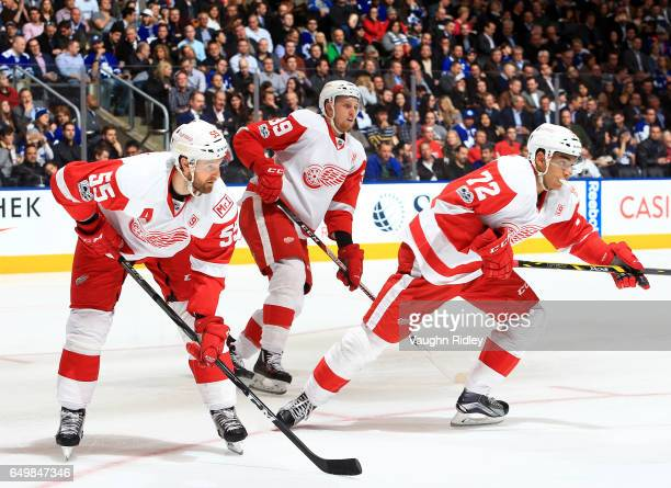 Niklas Kronwall Anthony Mantha and Andreas Athanasiou of the Detroit Red Wings prepare for a faceoff during an NHL game against the Toronto Maple...