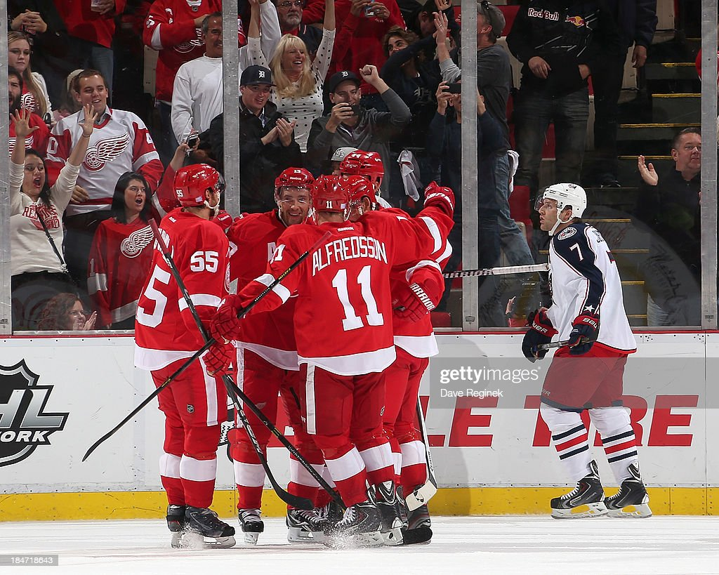 Niklas Kronwall #55, Daniel Alfredsson #11, Todd Bertuzzi #44 and Henrik Zetterberg #40 of the Detroit Red Wings gather around teammate Pavel Datsyuk #13 after scoring a 2nd period goal during a NHL game against the Columbus Blue Jackets at Joe Louis Arena on October 15, 2013 in Detroit, Michigan.