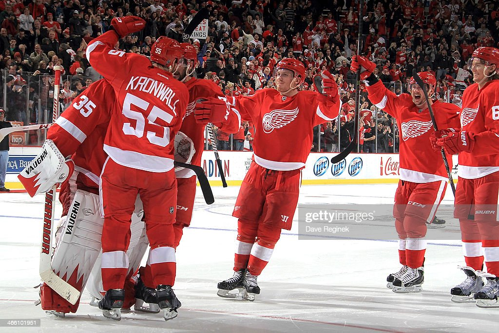 Niklas Kronwall #55, Gustav Nyquist #14, Tomas Tatar #21, Danny DeKeyser #65 and Jimmy Howard #35 of the Detroit Red Wings celebrate the 3-2 shoot-out win over the Los Angeles Kings during an NHL game on January 18, 2014 at Joe Louis Arena in Detroit, Michigan.