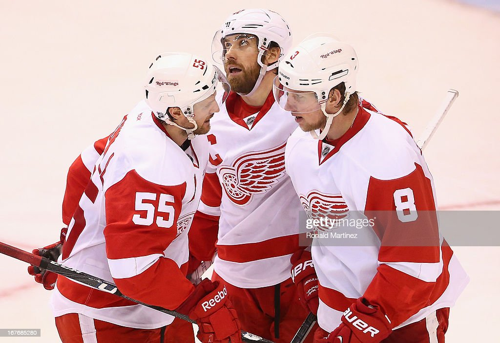 Niklas Kronwall #55, Henrik Zetterberg #40 and Justin Abdelkader #8 of the Detroit Red Wings celebrate a goal against the Dallas Stars at American Airlines Center on April 27, 2013 in Dallas, Texas.