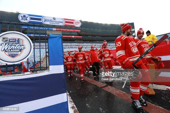 Niklas Kronwall Jonas Gustavsson of the Detroit Red Wings and their teammates walk to the ice surface during 2014 Bridgestone NHL Winter Classic team...