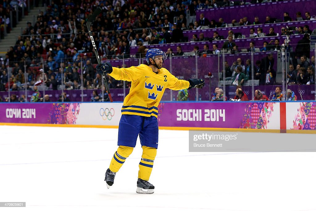 Niklas Kronwall of Sweden celebrates winning the game against Finland 21 during the Men's Ice Hockey Semifinal Playoff on Day 14 of the 2014 Sochi...