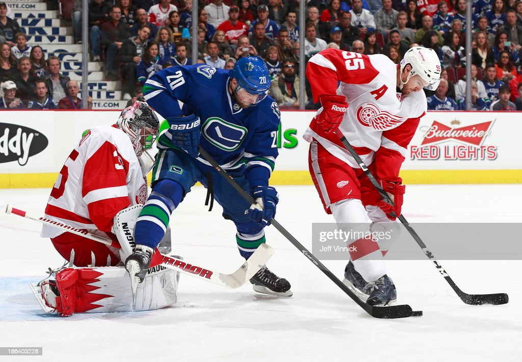 <a gi-track='captionPersonalityLinkClicked' href=/galleries/search?phrase=Niklas+Kronwall&family=editorial&specificpeople=220826 ng-click='$event.stopPropagation()'>Niklas Kronwall</a> #55 of the Detroit Red Wings and Chris Higgins #20 of the Vancouver Canucks battle for a rebound in front of <a gi-track='captionPersonalityLinkClicked' href=/galleries/search?phrase=Jimmy+Howard&family=editorial&specificpeople=2118637 ng-click='$event.stopPropagation()'>Jimmy Howard</a> #35 of the Detroit Red Wings during their NHL game at Rogers Arena on October 30, 2013 in Vancouver, British Columbia, Canada. Detroit won 2-1.