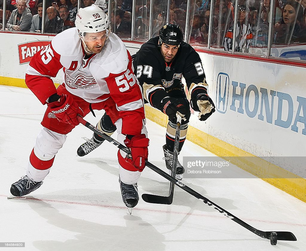 <a gi-track='captionPersonalityLinkClicked' href=/galleries/search?phrase=Niklas+Kronwall&family=editorial&specificpeople=220826 ng-click='$event.stopPropagation()'>Niklas Kronwall</a> #55 of the Detroit Red Wings and <a gi-track='captionPersonalityLinkClicked' href=/galleries/search?phrase=Daniel+Winnik&family=editorial&specificpeople=2529214 ng-click='$event.stopPropagation()'>Daniel Winnik</a> #34 of the Anaheim Ducks fight for the puck along the boards on March 24, 2013 at Honda Center in Anaheim, California.