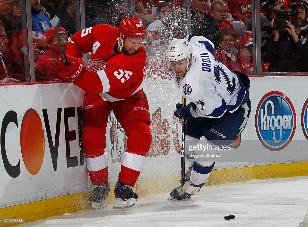 <a gi-track='captionPersonalityLinkClicked' href=/galleries/search?phrase=Niklas+Kronwall&family=editorial&specificpeople=220826 ng-click='$event.stopPropagation()'>Niklas Kronwall</a> #55 of the Detroit Red Wings battles for the puck with <a gi-track='captionPersonalityLinkClicked' href=/galleries/search?phrase=Jonathan+Drouin+-+Ice+Hockey+Player&family=editorial&specificpeople=10884241 ng-click='$event.stopPropagation()'>Jonathan Drouin</a> #27 of the Tampa Bay Lightning during the third period of Game Four of the Eastern Conference First Round during the 2016 NHL Stanley Cup Playoffs at Joe Louis Arena on April 19, 2016 in Detroit, Michigan. Tampa Bay won the game 3-2. Tampa Bay leads the series 3-1.