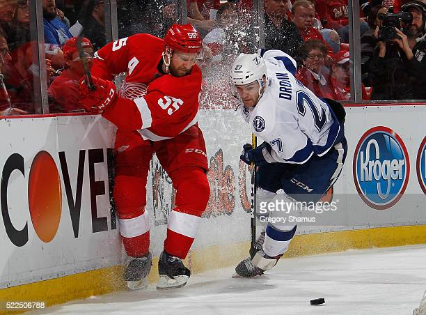Niklas Kronwall of the Detroit Red Wings battles for the puck with Jonathan Drouin of the Tampa Bay Lightning during the third period of Game Four of...