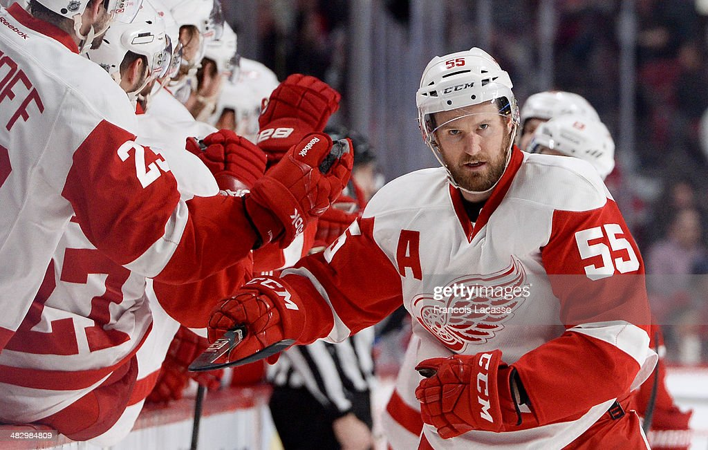 <a gi-track='captionPersonalityLinkClicked' href=/galleries/search?phrase=Niklas+Kronwall&family=editorial&specificpeople=220826 ng-click='$event.stopPropagation()'>Niklas Kronwall</a> #55 of the Detroit Red Wings celebrates after scoring a goal against the Montreal Canadiens during the NHL game on April 5, 2014 at the Bell Centre in Montreal, Quebec, Canada.