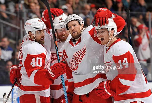 Niklas Kronwall of the Detroit Red Wings celebrates his first period goal with teammates during NHL game action December 13 2014 at the Air Canada...