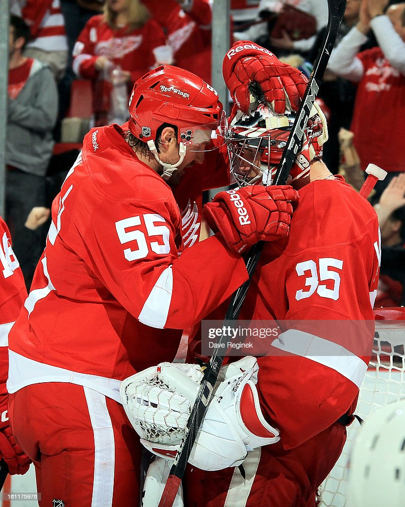 <a gi-track='captionPersonalityLinkClicked' href=/galleries/search?phrase=Niklas+Kronwall&family=editorial&specificpeople=220826 ng-click='$event.stopPropagation()'>Niklas Kronwall</a> #55 of the Detroit Red Wings celebrates with teamate <a gi-track='captionPersonalityLinkClicked' href=/galleries/search?phrase=Jimmy+Howard&family=editorial&specificpeople=2118637 ng-click='$event.stopPropagation()'>Jimmy Howard</a> #35 after a NHL game against the Edmonton Oilers at Joe Louis Arena on February 9, 2013 in Detroit, Michigan. Detroit defeated Edmonton 2-1