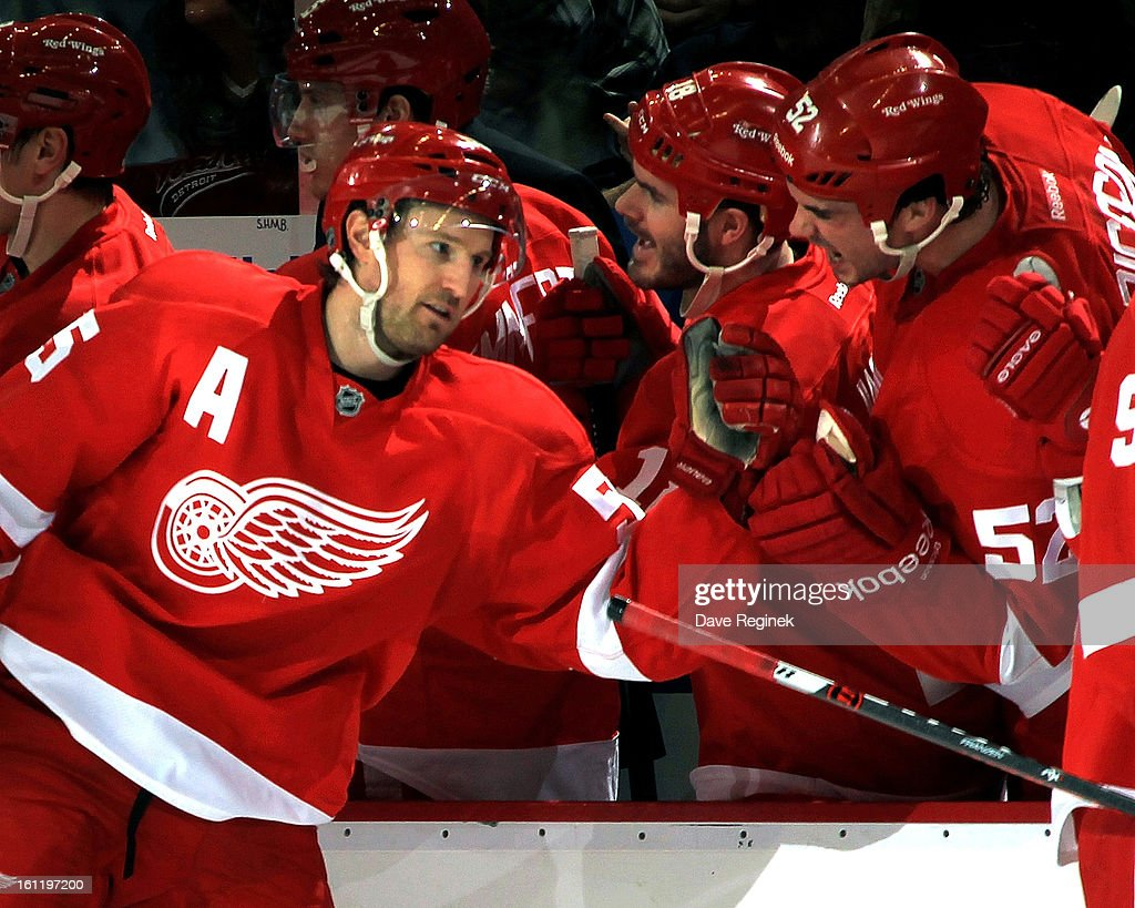 Niklas Kronwall of the Detroit Red Wings celebrates with teamates Ian White and Jonathan Ericsson after scoring the game winning goal in a NHL game...