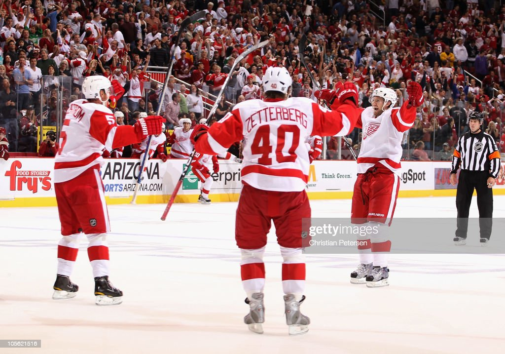 Niklas Kronwall of the Detroit Red Wings celebrates with teammates Nicklas Lidstrom and Henrik Zetterberg after Kronwall scored the game winning...