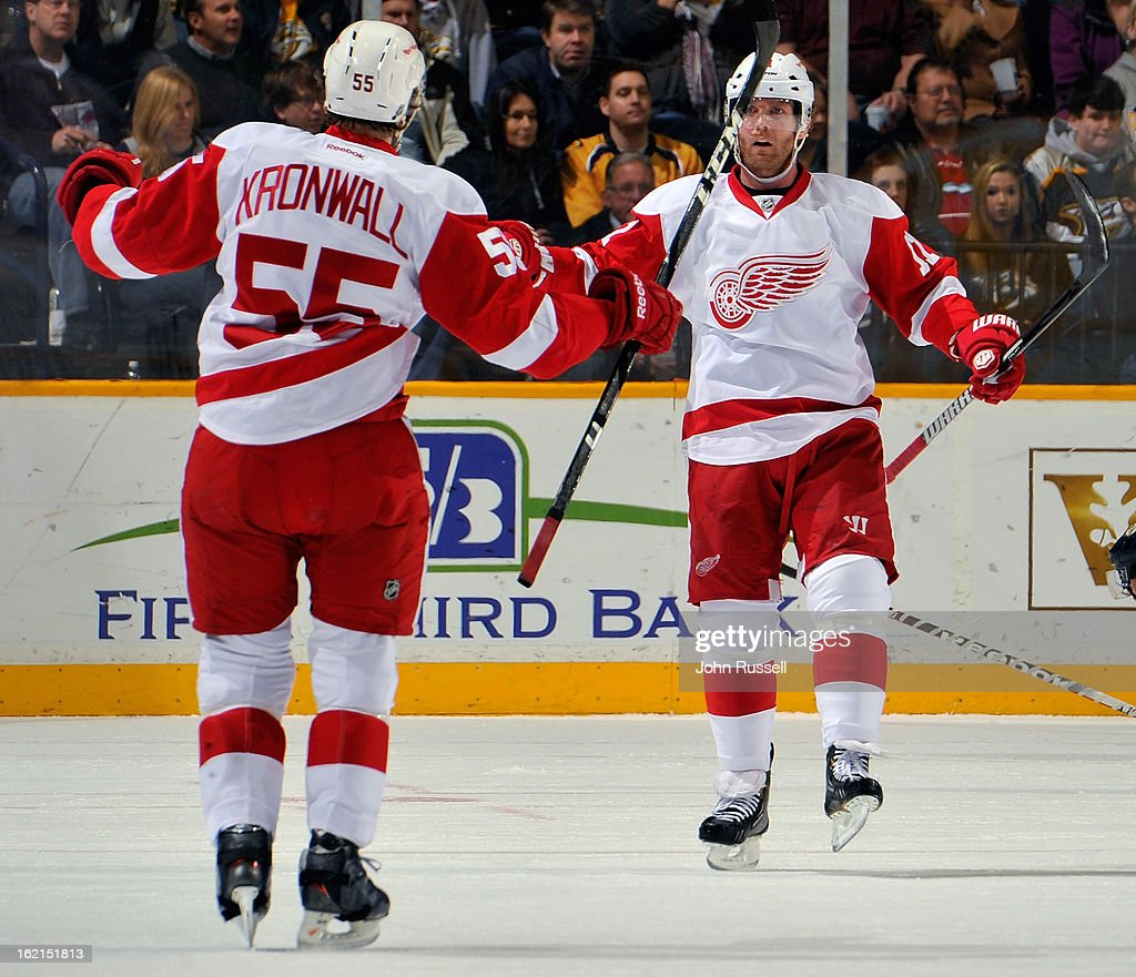 Niklas Kronwall #55 of the Detroit Red Wings congratulates teammate Danny Cleary #11 on scoring a goal against the Nashville Predators at Bridgestone Arena on February 19, 2013 in Nashville, Tennessee.