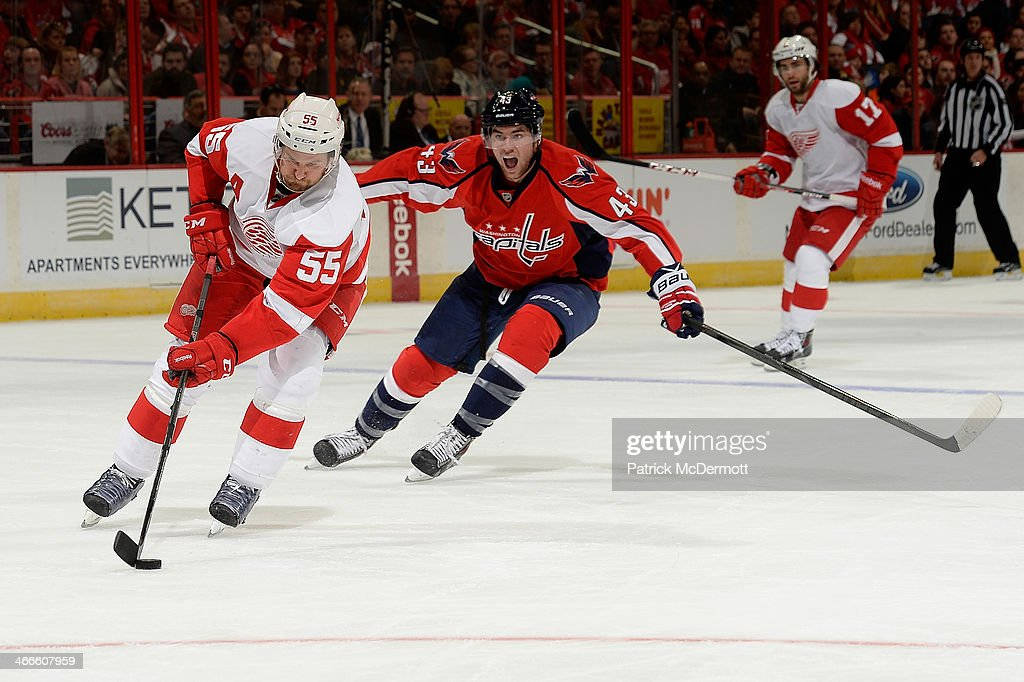 <a gi-track='captionPersonalityLinkClicked' href=/galleries/search?phrase=Niklas+Kronwall&family=editorial&specificpeople=220826 ng-click='$event.stopPropagation()'>Niklas Kronwall</a> #55 of the Detroit Red Wings controls the puck as he is pursued by Tom Wilson #43 of the Washington Capitals in the second period during an NHL game at Verizon Center on February 2, 2014 in Washington, DC.