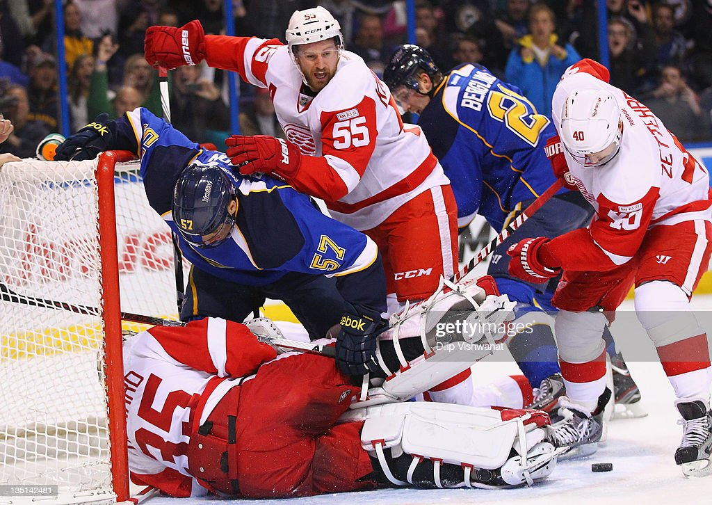 Niklas Kronwall of the Detroit Red Wings defends against David Perron of the St Louis Blues at the Scottrade Center on December 6 2011 in St Louis...