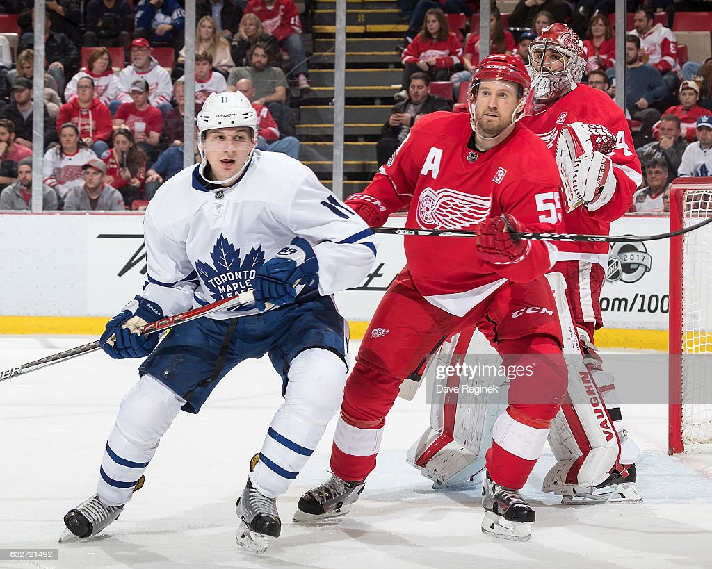 Niklas Kronwall #55 of the Detroit Red Wings defends against Zach Hyman #11 of the Toronto Maple Leafs in front of teammate goaltender Petr Mrazek #34 of the Wings during an NHL game at Joe Louis Arena on January 25, 2017 in Detroit, Michigan.