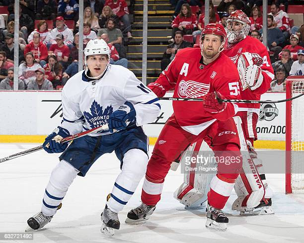 Niklas Kronwall of the Detroit Red Wings defends against Zach Hyman of the Toronto Maple Leafs in front of teammate goaltender Petr Mrazek of the...