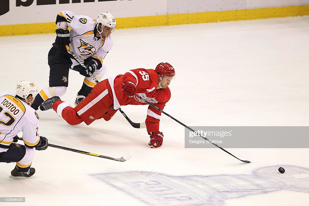 <a gi-track='captionPersonalityLinkClicked' href=/galleries/search?phrase=Niklas+Kronwall&family=editorial&specificpeople=220826 ng-click='$event.stopPropagation()'>Niklas Kronwall</a> #55 of the Detroit Red Wings dives for the puck in front of <a gi-track='captionPersonalityLinkClicked' href=/galleries/search?phrase=Sergei+Kostitsyn&family=editorial&specificpeople=599906 ng-click='$event.stopPropagation()'>Sergei Kostitsyn</a> #74 of the Nashville Predators during Game Three of the Western Conference Quarterfinals during the 2012 NHL Stanley Cup Playoffs at Joe Louis Arena on April 15, 2012 in Detroit, Michigan.