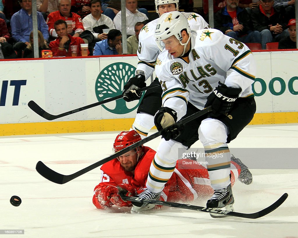 Niklas Kronwall #55 of the Detroit Red Wings dives to knock the puck off of Ray Whitney #13 of the Dallas Stars stick during an NHL game at Joe Louis Arena on January 29, 2013 in Detroit, Michigan.