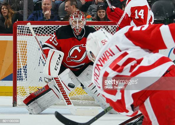 Niklas Kronwall of the Detroit Red Wings fires a shot at Cory Schneider of the New Jersey Devils at the Prudential Center on December 11 2015 in...
