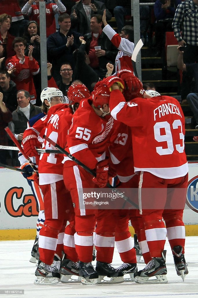 Niklas Kronwall #55 of the Detroit Red Wings gets surrounded by teamates Johan Franzen #93, Pavel Datysuk #13, Damien Brunner #24 and Henrik Zetterberg #40 after scoring the game winning goal in a NHL game against the Edmonton Oilers at Joe Louis Arena on February 9, 2013 in Detroit, Michigan. Detroit defeated Edmonton 2-1