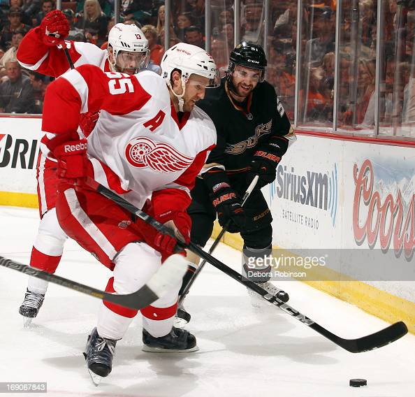 Niklas Kronwall of the Detroit Red Wings handles the puck against Kyle Palmieri of the Anaheim Ducks in Game Seven of the Western Conference...