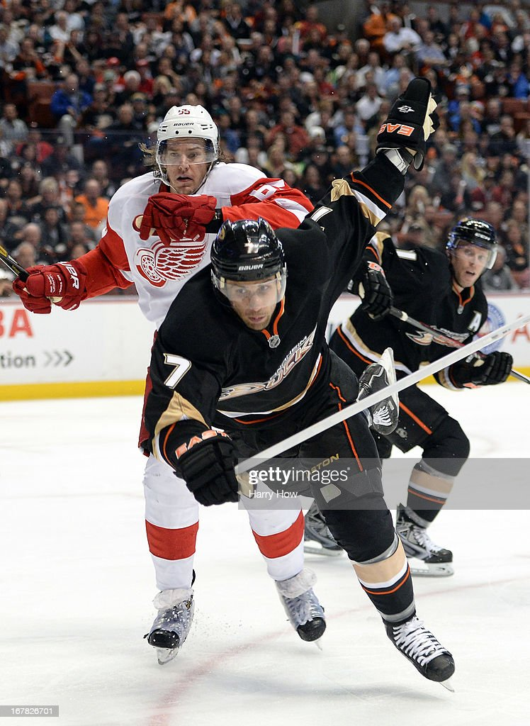 <a gi-track='captionPersonalityLinkClicked' href=/galleries/search?phrase=Niklas+Kronwall&family=editorial&specificpeople=220826 ng-click='$event.stopPropagation()'>Niklas Kronwall</a> #55 of the Detroit Red Wings hits <a gi-track='captionPersonalityLinkClicked' href=/galleries/search?phrase=Andrew+Cogliano&family=editorial&specificpeople=869296 ng-click='$event.stopPropagation()'>Andrew Cogliano</a> #7 of the Anaheim Ducks in front of the net during a 3-1 Ducks win in Game One of the Western Conference Quarterfinals during the 2013 Stanley Cup Playoffs at Honda Center on April 30, 2013 in Anaheim, California.