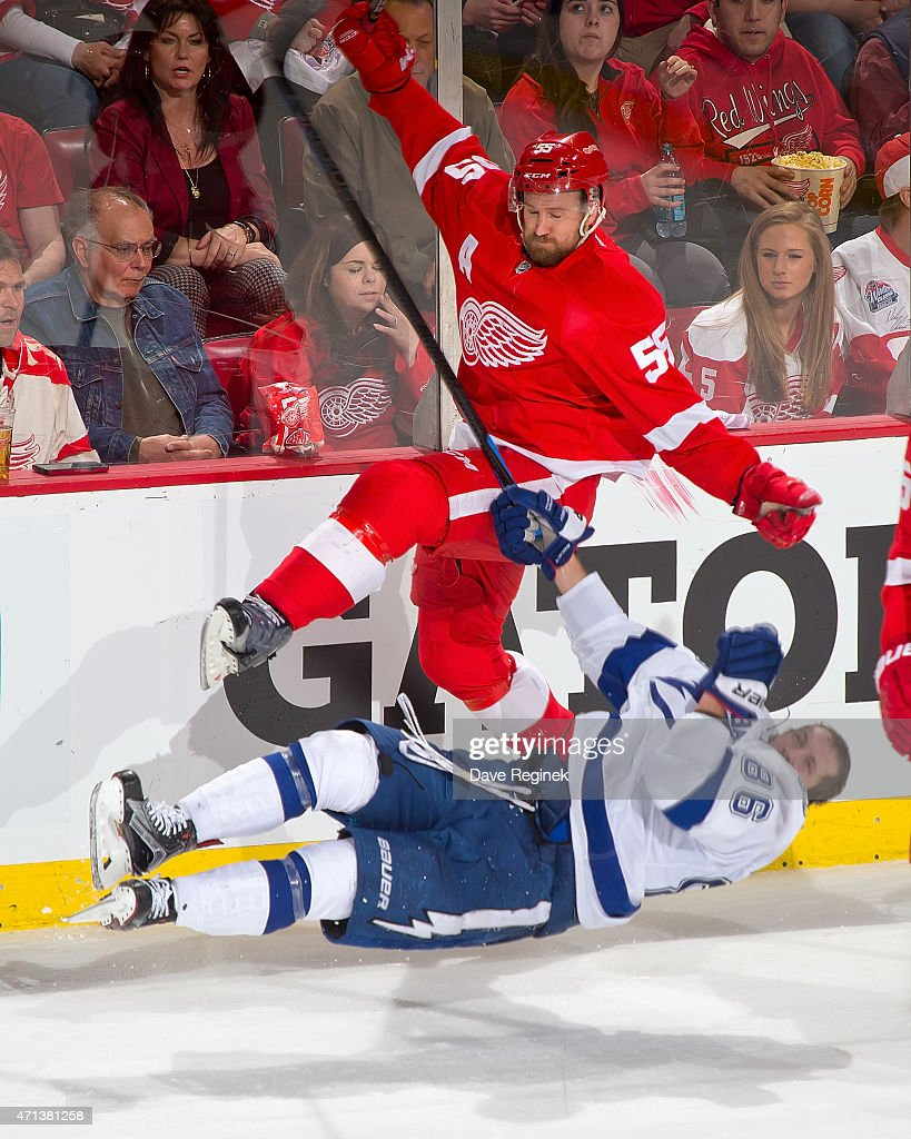 Niklas Kronwall of the Detroit Red Wings lays a big hit on Nikita Kucherov of the Tampa Bay Lightning in Game Six of the Eastern Conference...