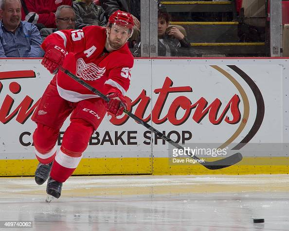 Niklas Kronwall of the Detroit Red Wings passes the puck during a NHL game against the Carolina Hurricanes on April 7 2015 at Joe Louis Arena in...