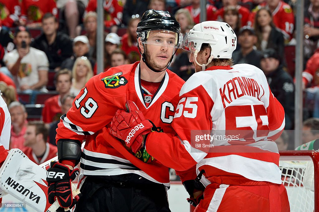 Niklas Kronwall #55 of the Detroit Red Wings pushes into Jonathan Toews #19 of the Chicago Blackhawks in Game Two of the Western Conference Semifinals during the 2013 Stanley Cup Playoffs at the United Center on May 18, 2013 in Chicago, Illinois.