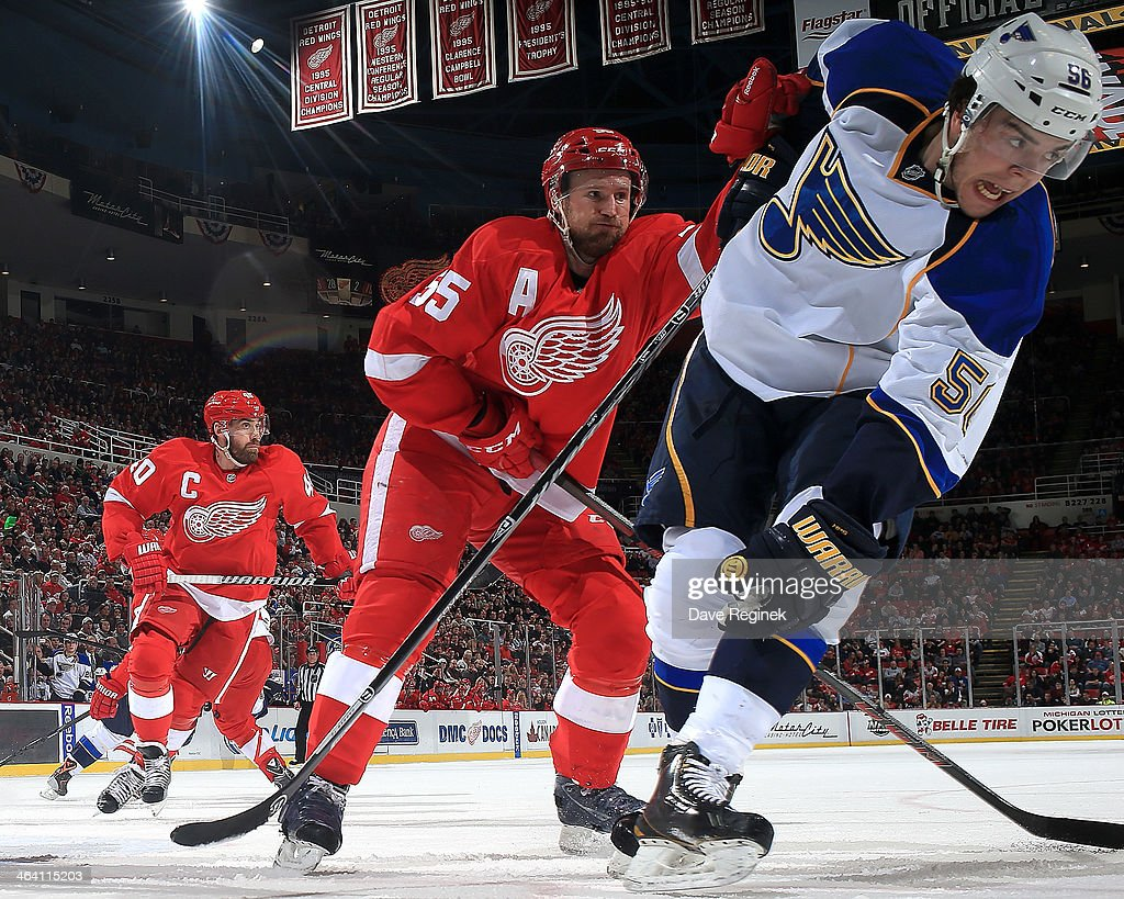 <a gi-track='captionPersonalityLinkClicked' href=/galleries/search?phrase=Niklas+Kronwall&family=editorial&specificpeople=220826 ng-click='$event.stopPropagation()'>Niklas Kronwall</a> #55 of the Detroit Red Wings pushes over Magnus Paajarvi #56 of the St. Louis Blues during an NHL game on January 20, 2014 at Joe Louis Arena in Detroit, Michigan.