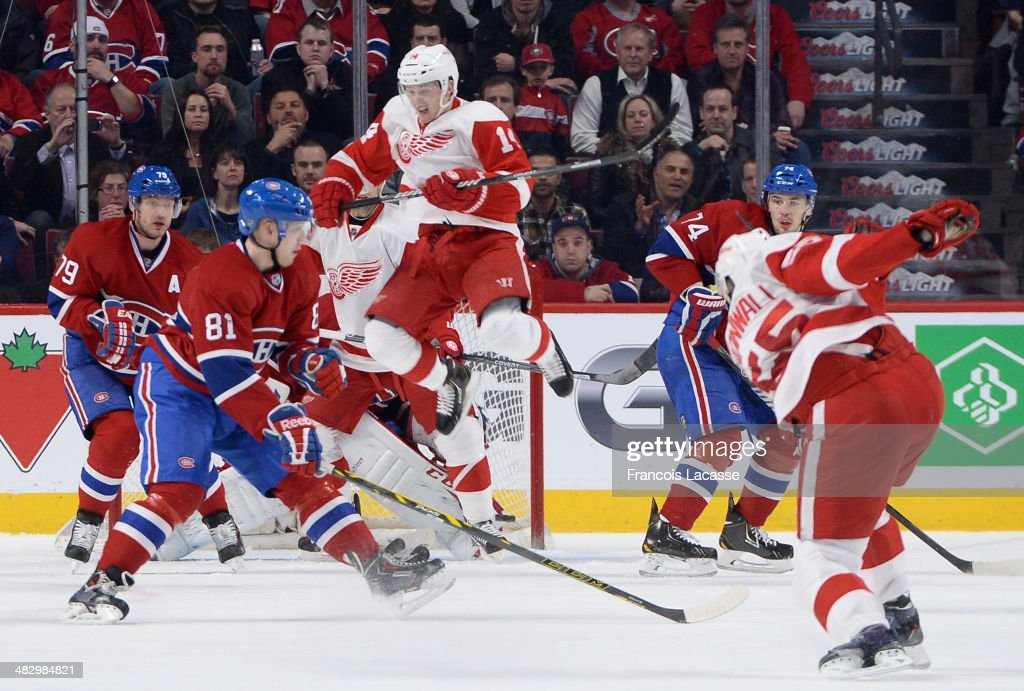 <a gi-track='captionPersonalityLinkClicked' href=/galleries/search?phrase=Niklas+Kronwall&family=editorial&specificpeople=220826 ng-click='$event.stopPropagation()'>Niklas Kronwall</a> #55 of the Detroit Red Wings scores a goal against the Montreal Canadiens while being challenged by <a gi-track='captionPersonalityLinkClicked' href=/galleries/search?phrase=Lars+Eller&family=editorial&specificpeople=4324947 ng-click='$event.stopPropagation()'>Lars Eller</a> #81 and <a gi-track='captionPersonalityLinkClicked' href=/galleries/search?phrase=Andrei+Markov&family=editorial&specificpeople=204528 ng-click='$event.stopPropagation()'>Andrei Markov</a> #79 and while <a gi-track='captionPersonalityLinkClicked' href=/galleries/search?phrase=Gustav+Nyquist&family=editorial&specificpeople=5491209 ng-click='$event.stopPropagation()'>Gustav Nyquist</a> #14 jumps up during the NHL game on April 5, 2014 at the Bell Centre in Montreal, Quebec, Canada.