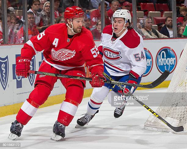Niklas Kronwall of the Detroit Red Wings skates around the net next to Charles Hudon of the Montreal Canadiens during an NHL game at Joe Louis Arena...