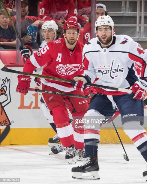 Niklas Kronwall of the Detroit Red Wings skates in his 800th career NHL game while defending against Tom Wilson and TJ Oshie of the Washington...