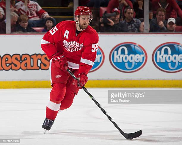 Niklas Kronwall of the Detroit Red Wings skates up ice with the puck during a NHL game against the San Jose Sharks on March 26 2015 at Joe Louis...