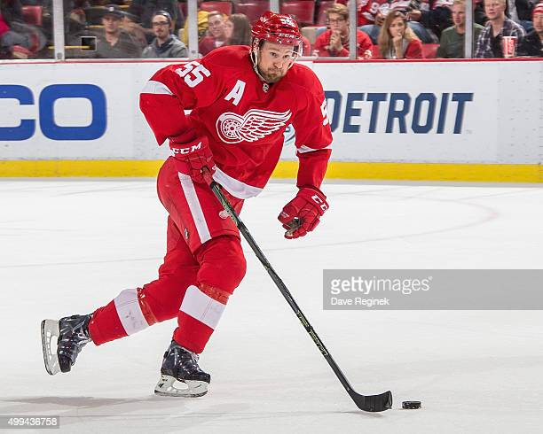Niklas Kronwall of the Detroit Red Wings skates up ice with the puck during an NHL game against the Edmonton Oilers at Joe Louis Arena on November 27...