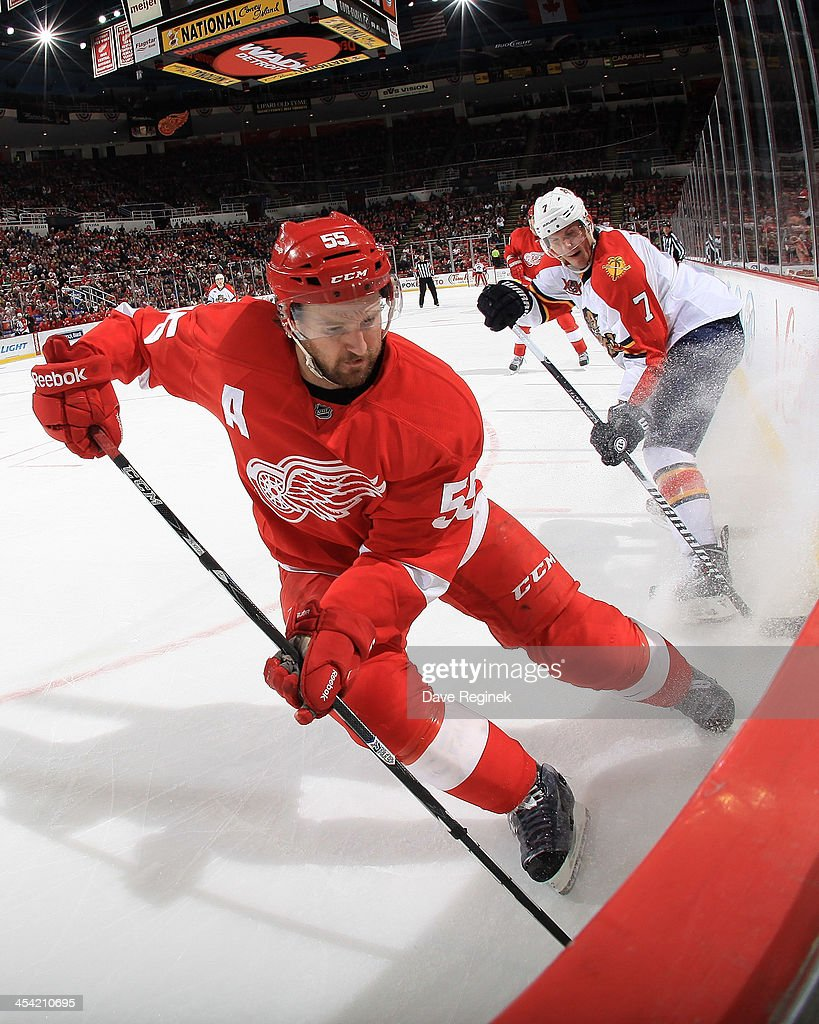 <a gi-track='captionPersonalityLinkClicked' href=/galleries/search?phrase=Niklas+Kronwall&family=editorial&specificpeople=220826 ng-click='$event.stopPropagation()'>Niklas Kronwall</a> #55 of the Detroit Red Wings strips the puck from Dmitry Kulikov #7 of the Florida Panthers along the boards during an NHL game at Joe Louis Arena on December 7, 2013 in Detroit, Michigan.